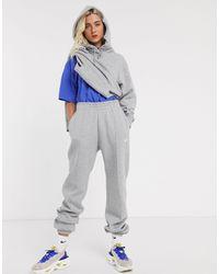 Nike – er Oversize-Kapuzenpullover mit kleinem Swoosh-Logo - Grau