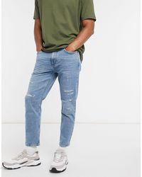 Pull&Bear Smalle Jeans Met Smaltoelopende Pijpen En Slijtplekken - Blauw