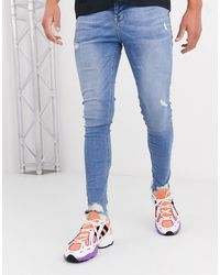 ASOS Spray On Jeans With Power Stretch And Raw Hem - Blue