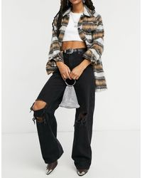 Bershka – Jeans im 90er Stil mit weitem Bein und Rissen am Knie - Schwarz