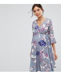 23942a4480a92 Bluebelle Maternity - Flared Sleeve Wrap Front Skater Dress In Floral - Lyst