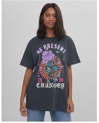 Bershka T-shirt oversize à délavage à l'acide avec imprimé graphique - Gris