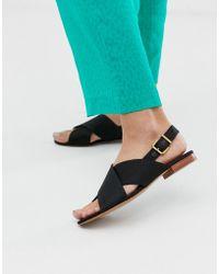& Other Stories Slinback-sandalen Met Gekruiste Bandjes In Zwart