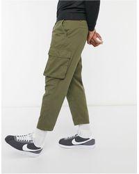 Another Influence Pantaloni cargo multitasche kaki - Verde