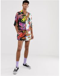 Jaded London – Festival – Shorts mit Halb-Halb-Drachen-Print, Kombiteil - Schwarz