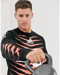 adidas Originals Adidas - Training Grfx - Sweater Met Print - Zwart