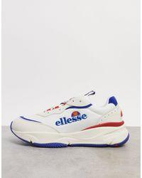 Ellesse Chunky sneakers en blanco con ribete en azul y rojo Massello
