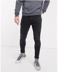 River Island Jeans skinny nero slavato effetto spray