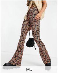 TOPSHOP Tall - pantalon évasé en jersey à fleurs - Multicolore