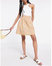 Y.A.S Mini-jupe boutonnée en coton biologique - Jaune fleuri - Neutre