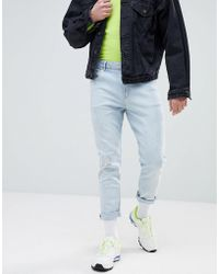 ASOS - Tapered Jeans In Light Wash Blue With Abrasions - Lyst
