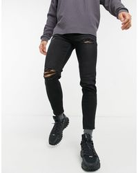 New Look Tapered Jeans With Rips - Black