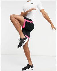 Nike Football Pantalones cortos en negro/rosa academy - Multicolor