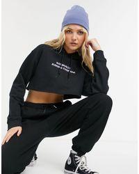 Skinnydip London Sudadera corta negra con capucha y texto - Negro