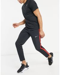 Nike Run Stripe - Joggers neri a righe - Nero