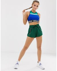 Reebok - Training Shorts With Taping In Green - Lyst