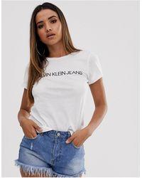 Calvin Klein T-shirt slim con logo istituzionale - Bianco