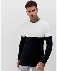 ASOS T-shirt manches longues moulant en coton bio stretch à empiècement contrastant - Noir