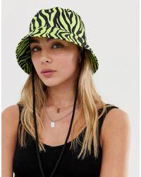 ffb4ade97 Eugenia Kim Genie By Logan Gray And Cream Zebra Print Hat With Knit ...
