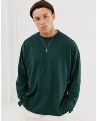 ASOS T-shirt long oversize à manches longues avec fentes latérales - Vert