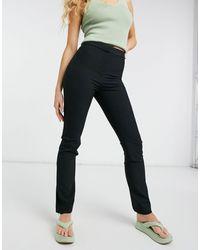 Weekday Alecia - Pantalon droit avec ourlet zippé - Noir
