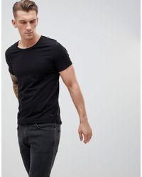 Produkt T-shirt à poche - Noir
