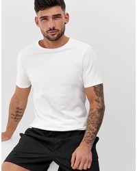 River Island Camiseta ajustada con cuello redondo en blanco