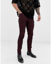 ASOS – Skinny-Jeans mit buntem Zebra-Print - Rot