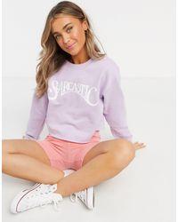 Skinnydip London Sweat-shirt oversize à inscription « Sarcastic » - Violet