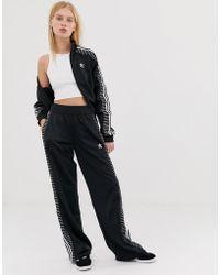 3c74ba2da4 Pantaloni sportivi con tre righe - Nero