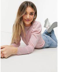 ASOS Jersey rosa con mangas abullonadas