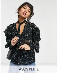 ASOS ASOS DESIGN Petite - Blusa con fiocco e stampa con stelle - Multicolore