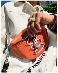 House of Holland Riñonera naranja estilo bandolera con logo en la correa y detalle - Multicolor