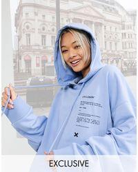 Collusion Sudadera extragrande azul con capucha y estampado