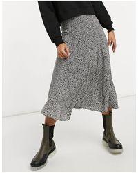 Warehouse Falda midi negra con estampado - Multicolor