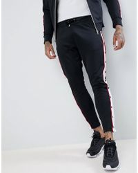 The Couture Club - Muscle Fit Skinny joggers In Black With Poppers - Lyst