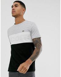 Lacoste Sport Lacoste - T-shirt cut and sew con logo sul petto grigia e nera - Nero
