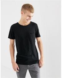Tom Tailor – T-Shirt mit Tasche und Rundhalsausschnitt - Schwarz