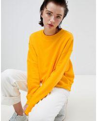 Weekday - Cropped Sweatshirt In Warm Yellow - Lyst
