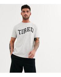 ASOS – Lounge – Pyjama-Set mit Shorts und T-Shirt mit Seitenstreifen und Slogan - Schwarz
