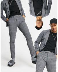 ASOS – Superenge, weich geschnittene Anzughose aus Wollmischung - Blau