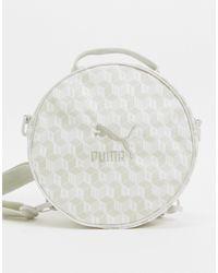 PUMA Mochila blanca unisex con diseño circular y estampado integral - Blanco