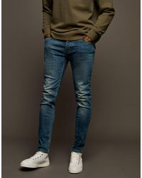 TOPMAN – Eng geschnittene Jeans mit Stretch - Blau