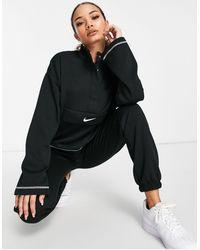 Nike – es Sweatshirt mit kurzem Reißverschluss, Stehkragen und Swoosh-Logo - Schwarz