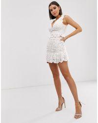 Love Triangle Mini-jupe en dentelle à volants - Blanc