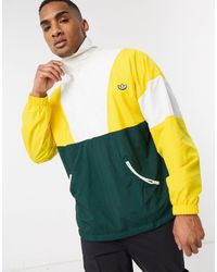 adidas Originals – Samstag – e Trainingsjacke mit kurzem Reißverschluss - Gelb