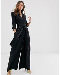 ASOS Smoking-Jumpsuit mit weitem Beinschnitt und tiefem Ausschnitt - Schwarz