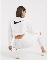 Nike – Kurzes, weißes Sweatshirt mit elastischem Kordelzug und kleinem Swoosh-Logo