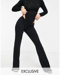 Fashionkilla Esclusiva - Pantaloni con fondo ampio e davanti a V neri - Nero