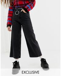 Reclaimed (vintage) The '93 - Jeans con fondo ampio nero slavato
